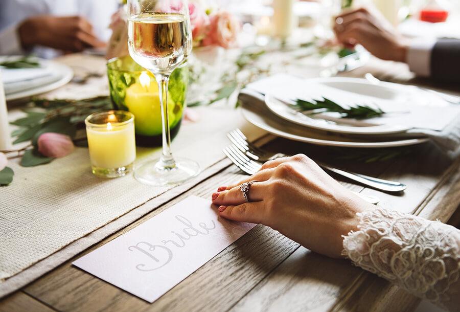 Bride at wedding breakfast table