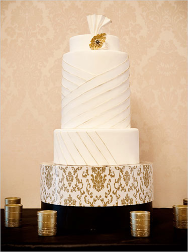 Simple white and gold wedding cake
